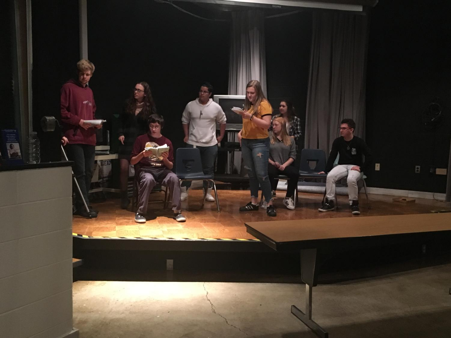 Drama club cast members rehearse their lines for upcoming play, Farce of Nature.