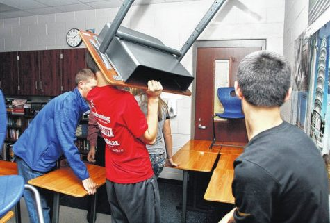 Students at Fairlawn high School in Sidney, Ohio prepare to baracade their classroom door against an intruder.  Courtesy Sidney Daily News.