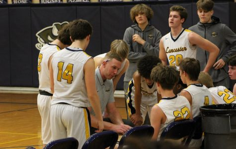 Coach Leitnaker talking with players.  Photo courtesy of Hallie Ritchie.