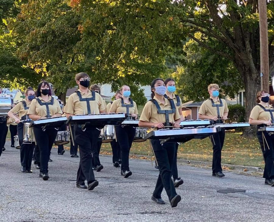LHS percussion march down neighborhood streets to play for Lancaster residents.
